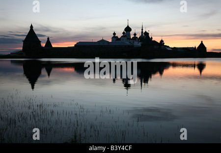 Solovetsky Monastery on the Solovetsky Islands in the White Sea, Russia. View from Saint Lake at sunset - Stock Photo