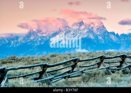 First light on fence and Grand Teton Mountains Grand Teton National Park WY - Stock Photo