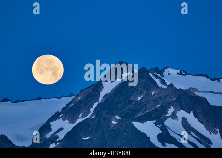 Moon set over the Olympic Mountains Olympic National Park Washington - Stock Photo