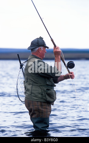 Scotland, Caithness, Ackergill Tower. Jimmy Sutherland the Ackergill ghillie fishing on Loch More for salmon - Stock Photo