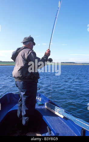 Scotland, Caithness, Ackergill Tower. Jimmy Sutherland the Ackergill ghillie getting ready for trout fishing on - Stock Photo