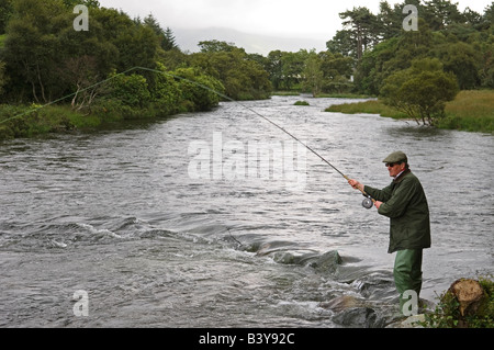 Scotland, Hebrides, Mull. A salmon fisherman fly fishing the Upper Rhubarb pool on the southern bank of the River - Stock Photo