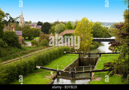 Lock at Little Bedwyn on the Kennet and Avon Canal with village and church in the distance.  Wiltshire, England, - Stock Photo