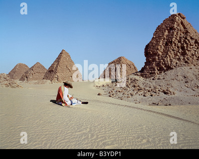 Sudan, Sahara Desert, Nuri. A tourist at the ancient pyramids at Nuri date between 700BC and 300BC. Nineteen kings - Stock Photo