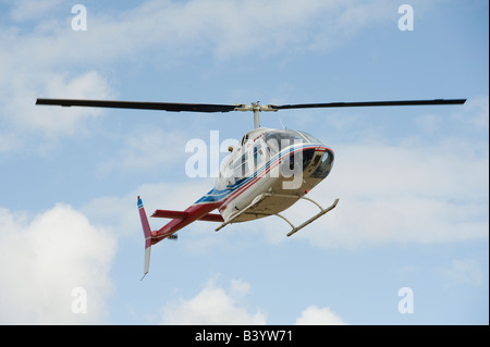Bell Jetranger two helicopter in flight - Stock Photo