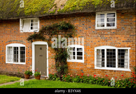 Typical thatched cottage in an English country village in Wiltshire. Taken at Little Bedwyn, Wiltshire, England, - Stock Photo