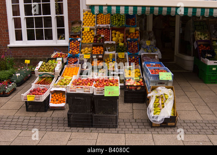 View of large selection of fresh fruit and vegetables outside Uk greengrocers - Stock Photo