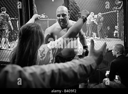 Winning fighter is greeted by family and fans. - Stock Photo