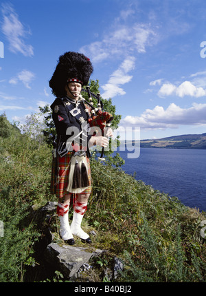 dh Scottish piper LOCH NESS INVERNESSSHIRE Traditional highlander Bagpipes tartan kilt scotland bagpiper dress one bagpipe player in highlands man