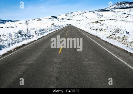 Perspective shot of road in snowy Colorado during winter - Stock Photo