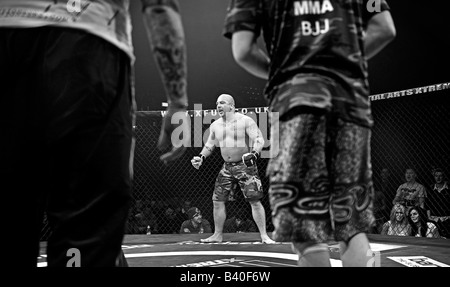 Cage Fighter in action during a Cage Wars competition held at Brahead arena in Glasgow MMA Fighters Mixed Martial - Stock Photo