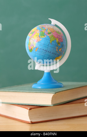 School education still life with globe on stack of books - Stock Photo