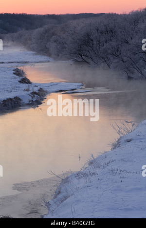 Hokkaido Island Japan Dawn on open waters of Setsuri River winter habitat for the Japanese crane near Kushiro - Stock Photo