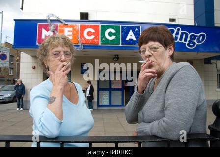 London September 2008 Mecca bingo Pat and Kay on a cigarette break - Stock Photo