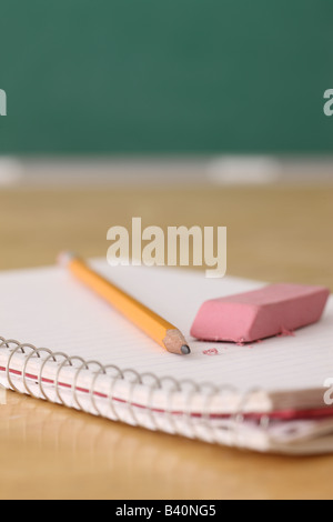School education still life of pencil and eraser on notebook - Stock Photo