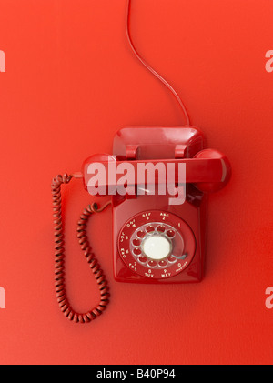 Red retro telephone on red background - Stock Photo