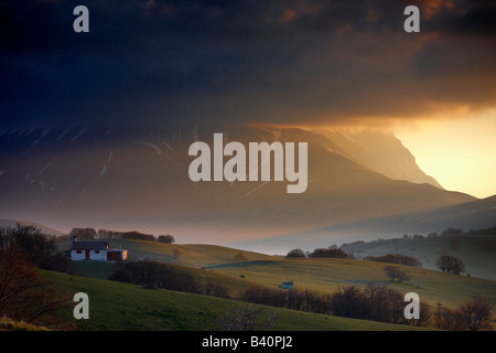 the mountains of Monti Sibillini National Park at dawn from the Forca della Canapine, Umbria, Italy - Stock Photo