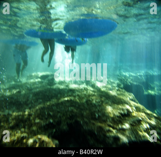 Tubers enter the clear waters of Ginnie Springs before floating out onto the Santa Fe River, Florida - Stock Photo