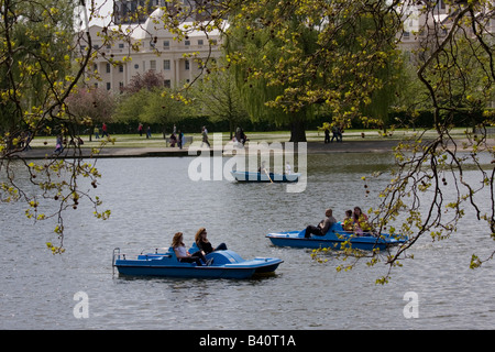 Regents Park boating Lake tourists in pedaloes London GB UK - Stock Photo