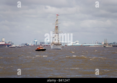 Norwegian sailing ship the Statsraad Lehmkuhl at the Tall Ships race in Liverpool July 2008 going down the Mersey - Stock Photo