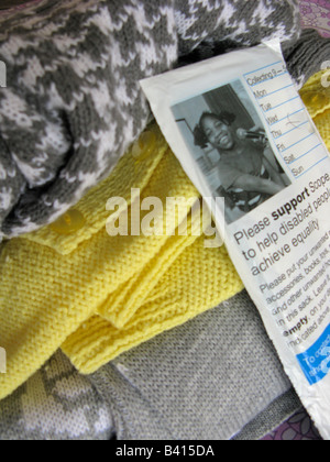 clothes for charity collection bag Scope for the disabled - Stock Photo