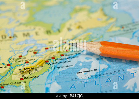 Pencil tip pointing the American east coast on a map - Stock Photo