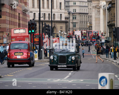 Busy traffic in the London city near Bank Station United Kingdom - Stock Photo