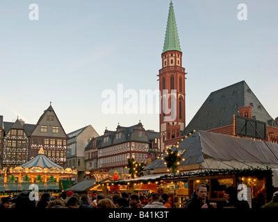 Christmas fair on the square Roemer Römer Römerberg booths stalls for food and merry go round in front of the Old - Stock Photo