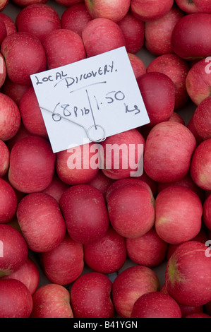 fresh local red Discovery apples on sale on market stall in Ludlow England UK - Stock Photo