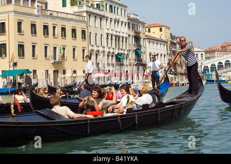 Taking a Gondola ride near the Rialto Bridge in Venice Italy - Stock Photo