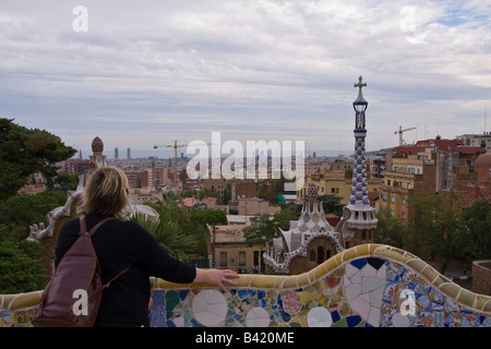 Tourist admiring the view from the upper level in Parc Guell Barcelona Spain - Stock Photo
