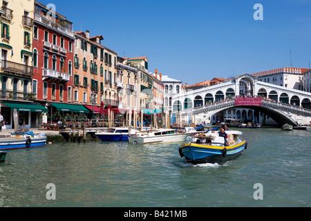 View down the Grand Canal towards the Ponte Di Rialto Bridge Venice Italy - Stock Photo