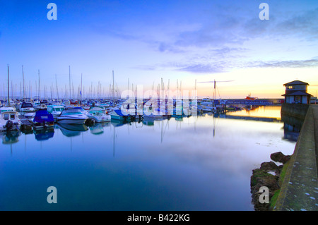 Daybreak at the marina of the small fishing town of Brixham on the South Devon coast - Stock Photo