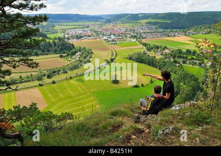 Mother and child enjoy the view towards Mühlheim an der Donau, Naturpark Obere Donau, Baden-Württemberg, Germany