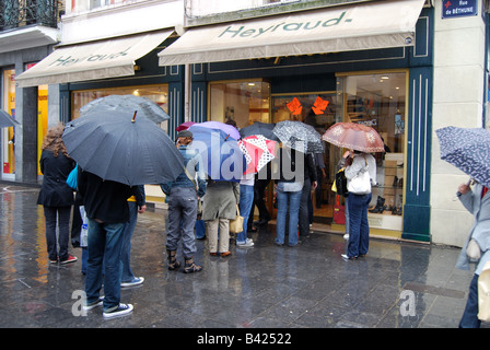 queue during seasonal bargain sale outside shoeshop Lille France - Stock Photo
