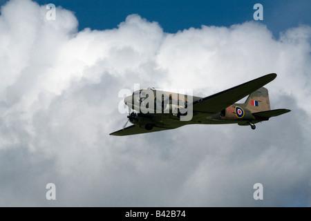 WWII RAF Douglas Dakota (Skytrain) flies over the battle re-enactment at Spanhoe Airfield, Northamptonshire Sept - Stock Photo