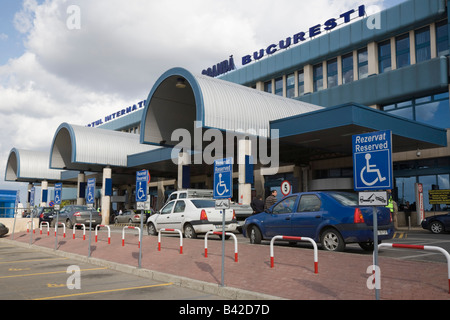 Bucharest Romania Otopeni Airport international departures building exterior with empty disabled parking bays in - Stock Photo