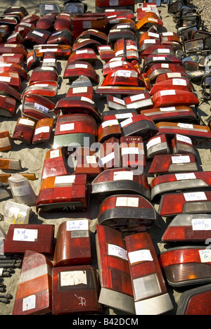 a series of labelled second hand rear brake lights from an assortment of cars at a 'car boot' sale - Stock Photo