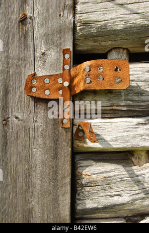 Leather hinge on the door of a hay drying barn ...