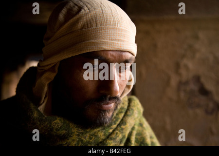 The face of one of the Doms, an untouchable who leads cremation ceremonies in Varanasi. - Stock Photo