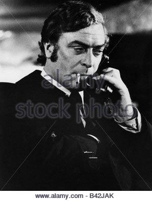 Caine, Michael, * 14.3.1933, British actor, half length, calling, uknown movie scene, circa 1971, Additional-Rights - Stock Photo