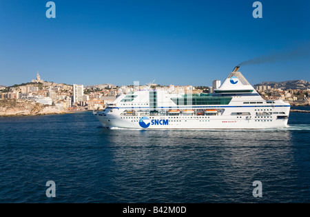 Ferry boat cruising into old port and third largest city in France, Marseille, Provence, France on the Mediterranean - Stock Photo