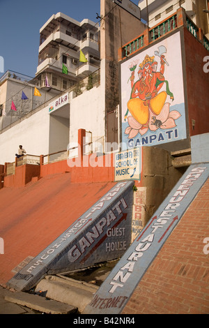 A picture of the Hindu god of new beginnings Ganpati (Ganesh) is painted onto a wall in the city of Varanasi, India. - Stock Photo
