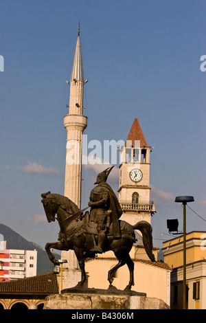 Skanderbeg monument in front of Ethem Bey Mosque on Skendenbeg Square, Tirana, Albania. - Stock Photo