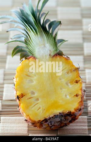 pineapple cut in half - Stock Photo