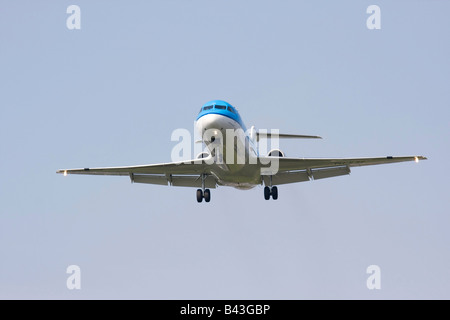 twin engine jet on approach to land - Stock Photo