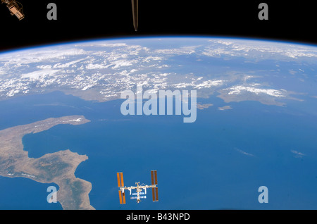 International Space Station above earth with a partial view of Italy - Stock Photo