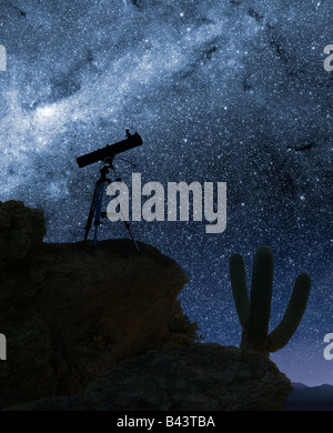 A telescope pointed at the stars from a desert mountain location - Stock Photo