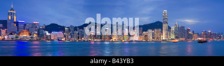 China Hong Kong Skyline viewed from Kowloon at dusk - Stock Photo