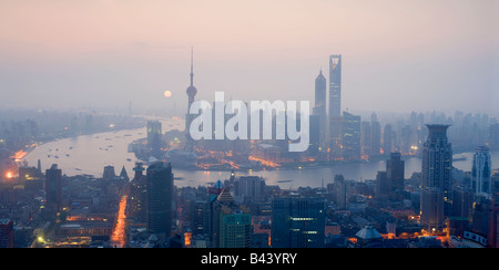 China Shanghai Elevated view of the financial Skyline viewed over the Huangpu river - Stock Photo